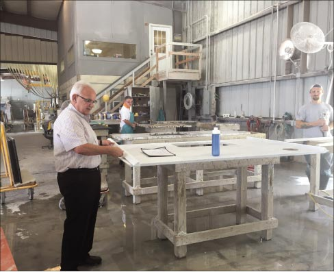 """G.K. Naquin in his Loxley, Alabama fabrication shop. """"I'm interested not only in the growth of Stone Interiors, but also increasing awareness about the industry's impact as a whole."""""""